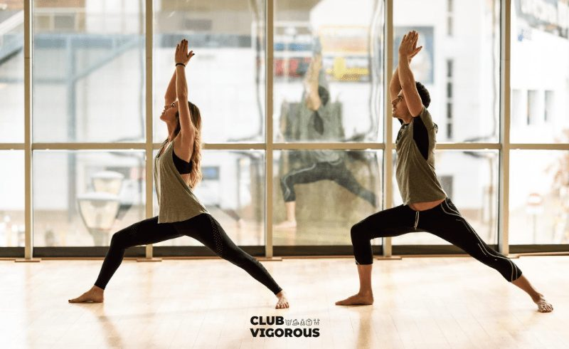 YOGA-POSE-COUPLE-DOING-WARRIOR-ONE-FOR-BETTER-HEALTH