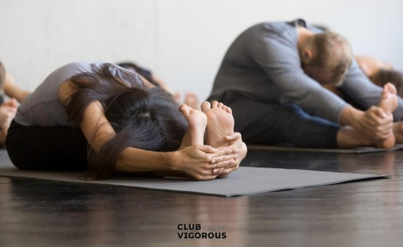 25-seated-forward-bend-partner-yoga-poses-2-people -yoga-poses-easy