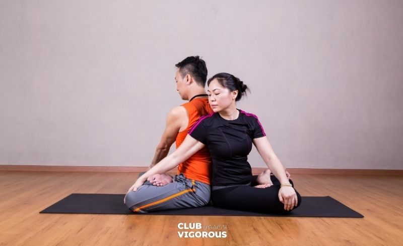 7-Situated-Twist-Situated Twist-yoga-poses-2-people-yoga-poses-easy